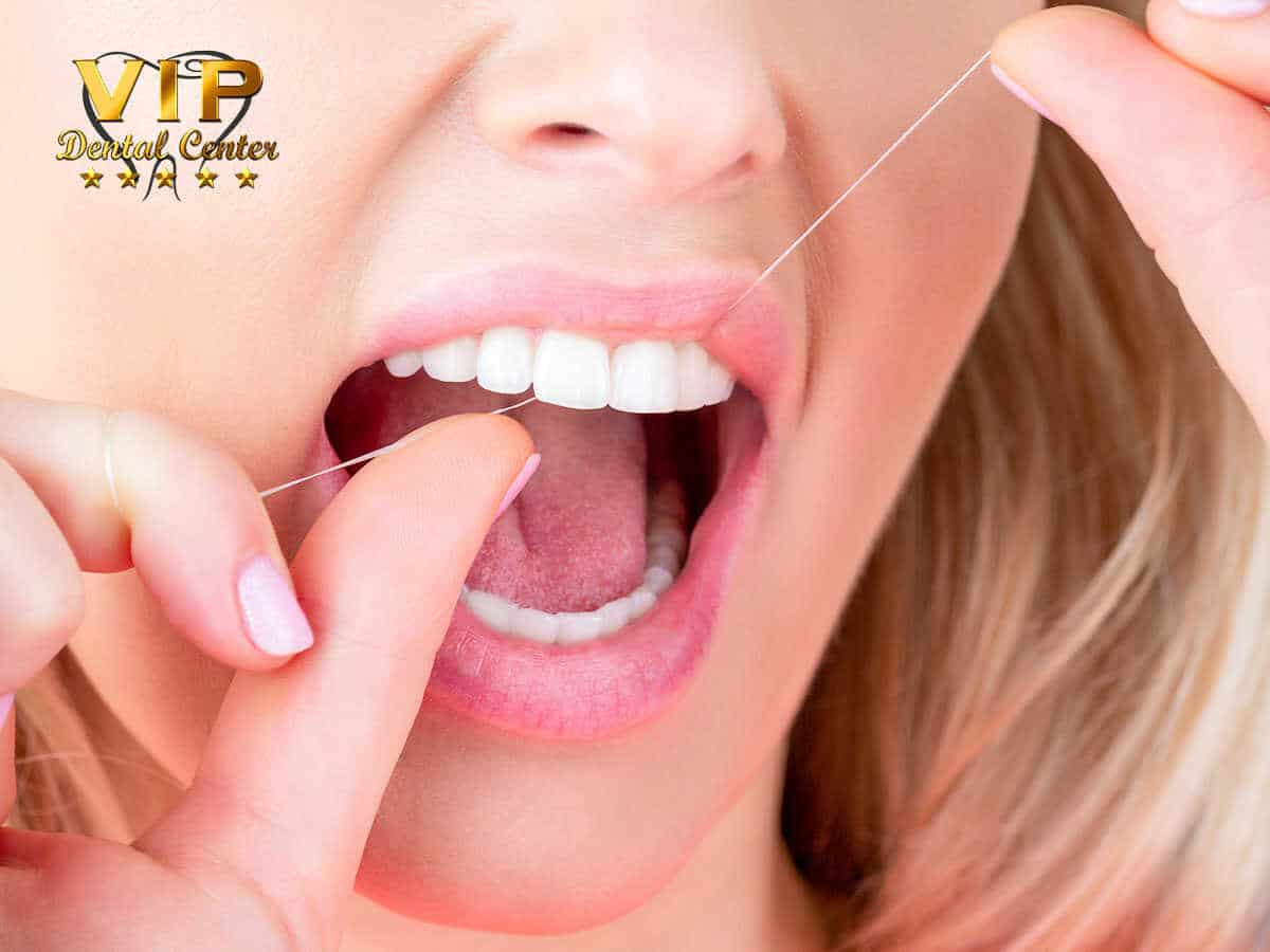 A woman flossing to have a good oral hygiene in Palm Harbor, FL